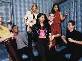 Friends dancing in padded room — Stock Photo
