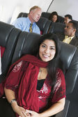 Portrait of woman on airplane — Stock Photo