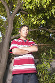 Portrait of teenage boy with arms crossed — Stock Photo