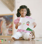 Young girl showing off her drawing — Stok fotoğraf