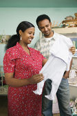 Couple shopping for baby clothes — Stock Photo