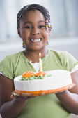 African American girl holding birthday cake — Stock Photo
