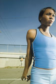 Female athlete stretching in urban surroundings — Stock Photo