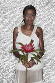 Portrait of African woman holding King Protea flower — Stock Photo