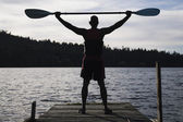 Young man holding canoe oar — Stock Photo