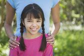 Hispanic girl smiling outdoors — Stock Photo