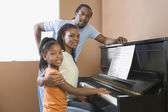 African family playing piano — Stock Photo