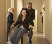 Businesspeople playing in hallway — Stock Photo