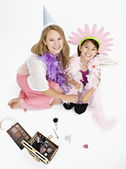 Studio shot of mother and daughter playing dress up — Stock Photo