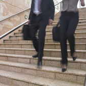 Blurred view of business legs — Stock Photo