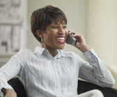 African businesswoman using telephone and smiling — Stock Photo