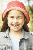 Close up of Hispanic girl smiling — Stock Photo