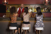 Hispanic women sitting at bar — Stock Photo