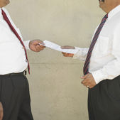 Midsection of businessmen holding papers — Stock Photo