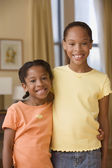 Sisters hugging for the camera — Stock Photo