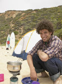 Portrait of man camping at beach — Stock Photo