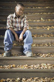 Portrait of African boy on steps — Stock Photo