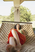 Woman relaxing in a hammock — Stock Photo
