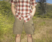 Man standing in rural setting — Stock Photo