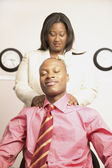 Businesswoman giving businessman massage — Stock Photo