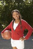Portrait of teenage girl with basketball — Stock Photo