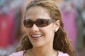 Portrait of teenage girl wearing sunglasses — Stock Photo