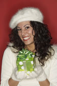 Portrait of young woman with gift — Stock Photo