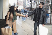 Couple holding hands on sidewalk — Stock Photo