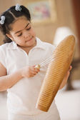 Young girl playing percussion instrument — Stock Photo
