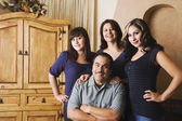 Portrait of Hispanic family indoors — Stock Photo