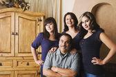 Portrait of Hispanic family indoors — Stock Photo