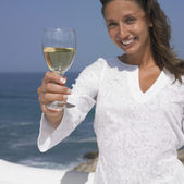 Woman smiling and holding wine glass — Stock Photo