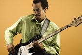 Man playing electric bass guitar — Stock Photo
