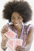African woman holding playing cards — Stock Photo
