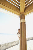 Hispanic woman outdoors at beach resort — Stock Photo
