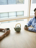 Couple having tea together — Stock Photo