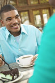 Man drinking coffee and eating pie — Stock Photo
