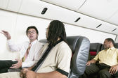 Passengers on airplane — Stock Photo