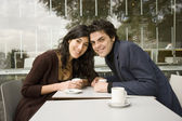 Hispanic couple smiling at cafe — Stock Photo