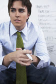 Young businessman looking pensive — Stock Photo