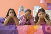 Three girls posing with hands over mouth, eyes and ears — Stock Photo