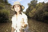 Explorer standing in riverbed — Stock Photo