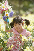 Portrait of girl with flowers — Stock Photo