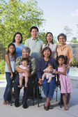 Multi-generational Asian family smiling outdoors — Stock Photo