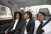 Students riding in the backseat — Stock Photo