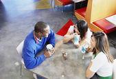 Teenagers talking at restaurant — Stock Photo