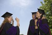Female graduates taking pictures — Stock Photo