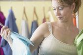 Hispanic women looking at men's clothes in boutique — Foto de Stock