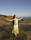 Sensual woman standing on hillside — Stock Photo