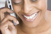 African American woman talking on cell phone — Stock Photo
